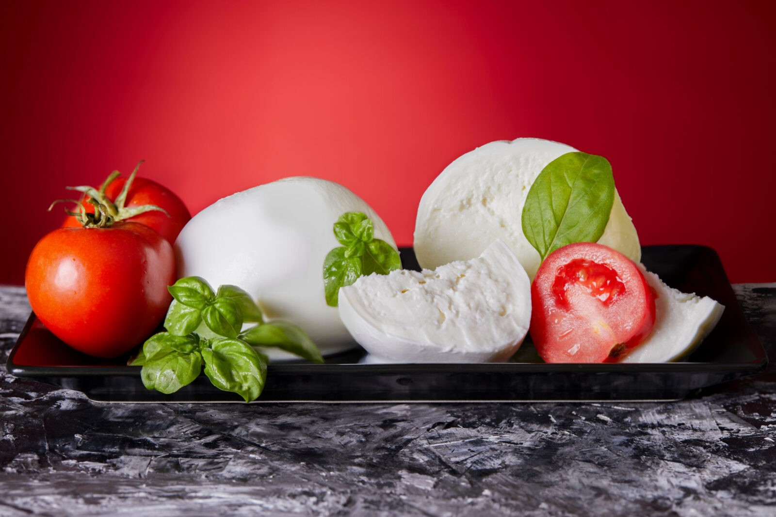Mozzarella cheese with fresh tomatoes and basil