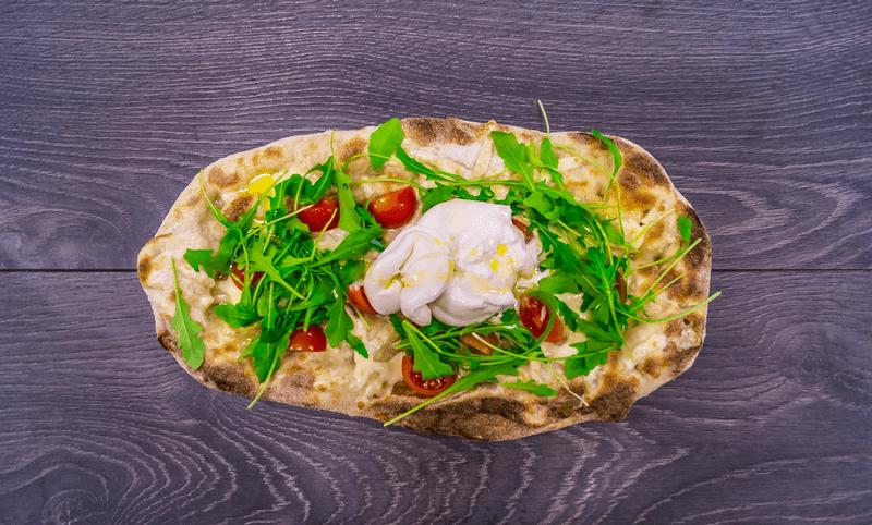 Pinsa Capri with Burrata cheese rocket salad and cherry Tomatoes